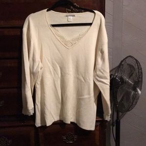 Cream color sweater with lace trim on neck and arm